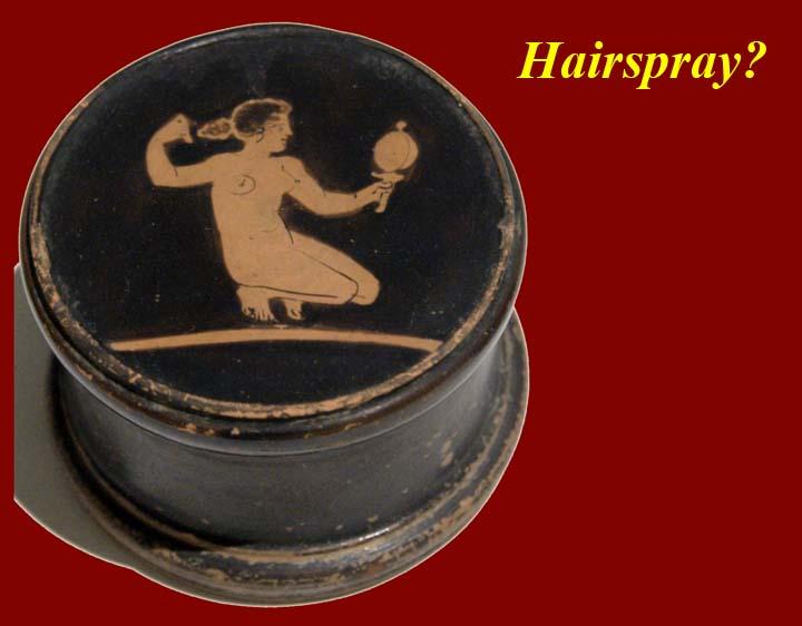 http://www.mmdtkw.org/Gr1826Woman_doing_her_hair_Louvre.jpg